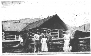 The Elmer family purchased the Roper cabin from Albert Roper. The young girl in the front is Alta Marie Dunbar, who was born in 1898 and died in 2002 at the age of 104. Her parents started Harmel's Ranch Resort nearby.